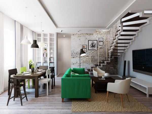 A vivid green sofa provides some design oomph in the center of the room a