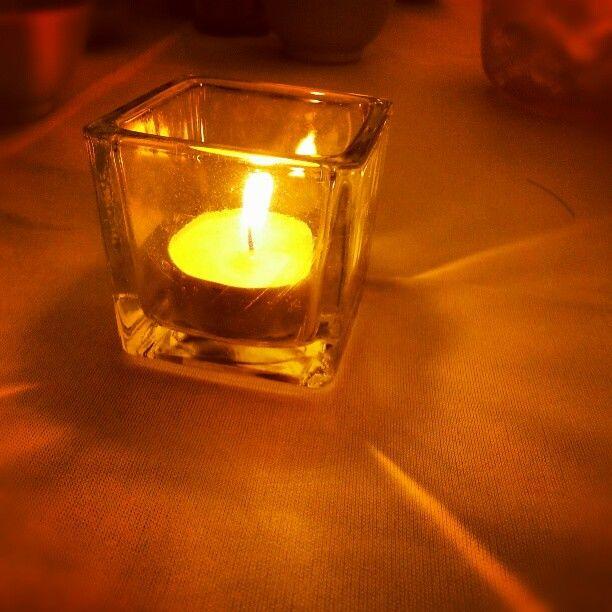 Candle light luminates within glass