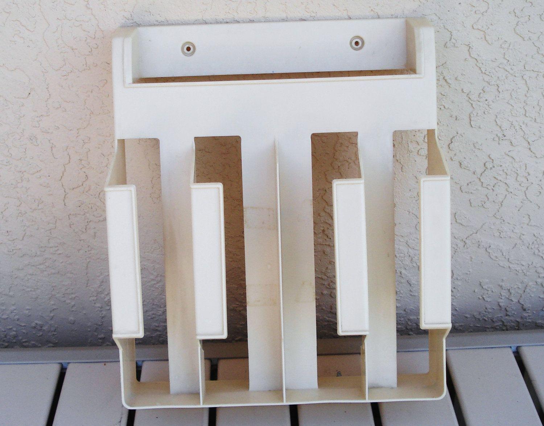 Rubbermaid wall mount draw organizer aluminum foil saran for Drawing on wax paper