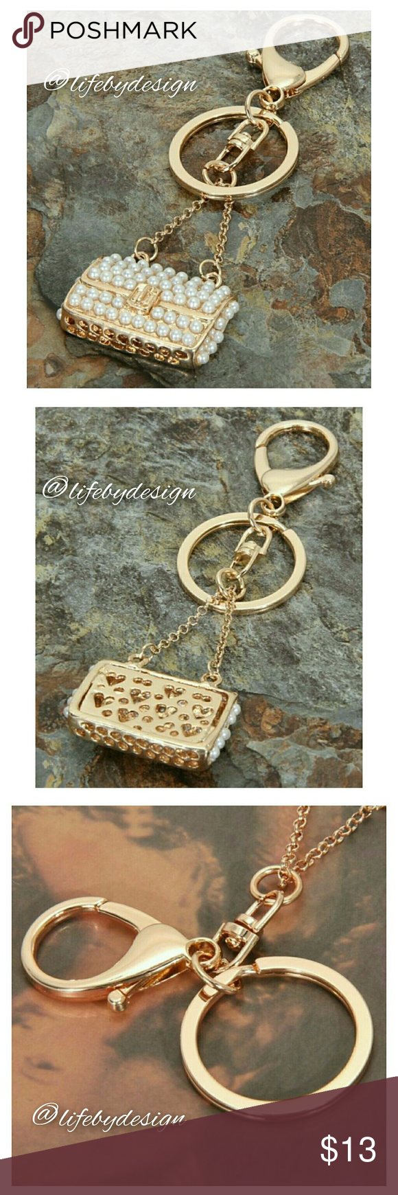 Gold Tone & Pearly Rhinestone Clutch Bag Keychain Cute as can be with pearly rhinestones studding this little clutch that eeven has a little latch opener. (Does not actually open, but cute) Hearts scatter the back of the clutch reminding you of the loved on who awaits for you at home...or whereever. ;)  Alloy metal and rhinestones. Life by Design  Accessories Key & Card Holders