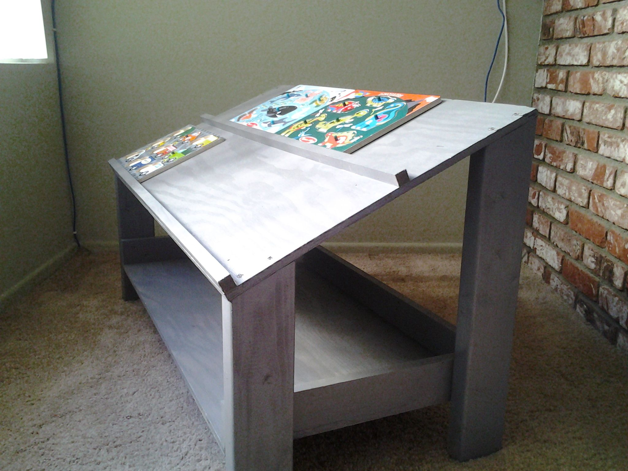 puzzle table 1 piece of plywood 2x4 for legs 1x4 for shelve and rh pinterest com