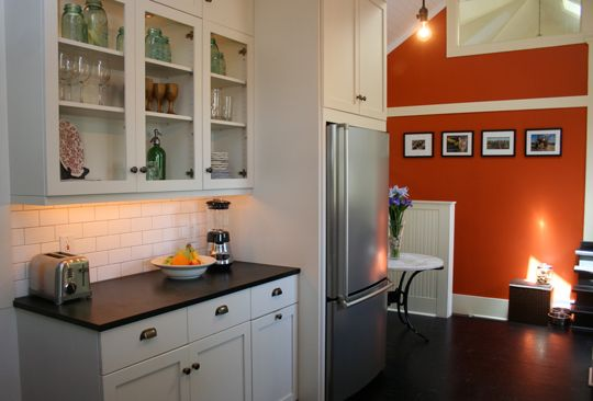 Orange Kitchen Walls With White Cabinets the bright orange wallkitchen with subway tile. this whole