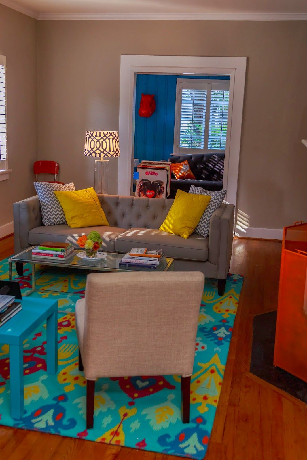 Living Room Orange Table Cb2 Turquoise Rug Yellow Pillows Fog Kendall Sofa