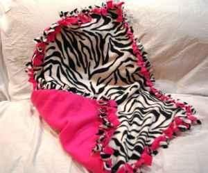 """These blankets are so easy to make! Overlap two pieces of fleese of the same size, cut out a 3""""x3"""" square at each corner and then proceed with cutting 1"""" wide and 3"""" long stips along the sides. Last step is to tie the two pieces of flees together using the cutout strips. The best part is that these can be made any size...even as a throw for an adult."""