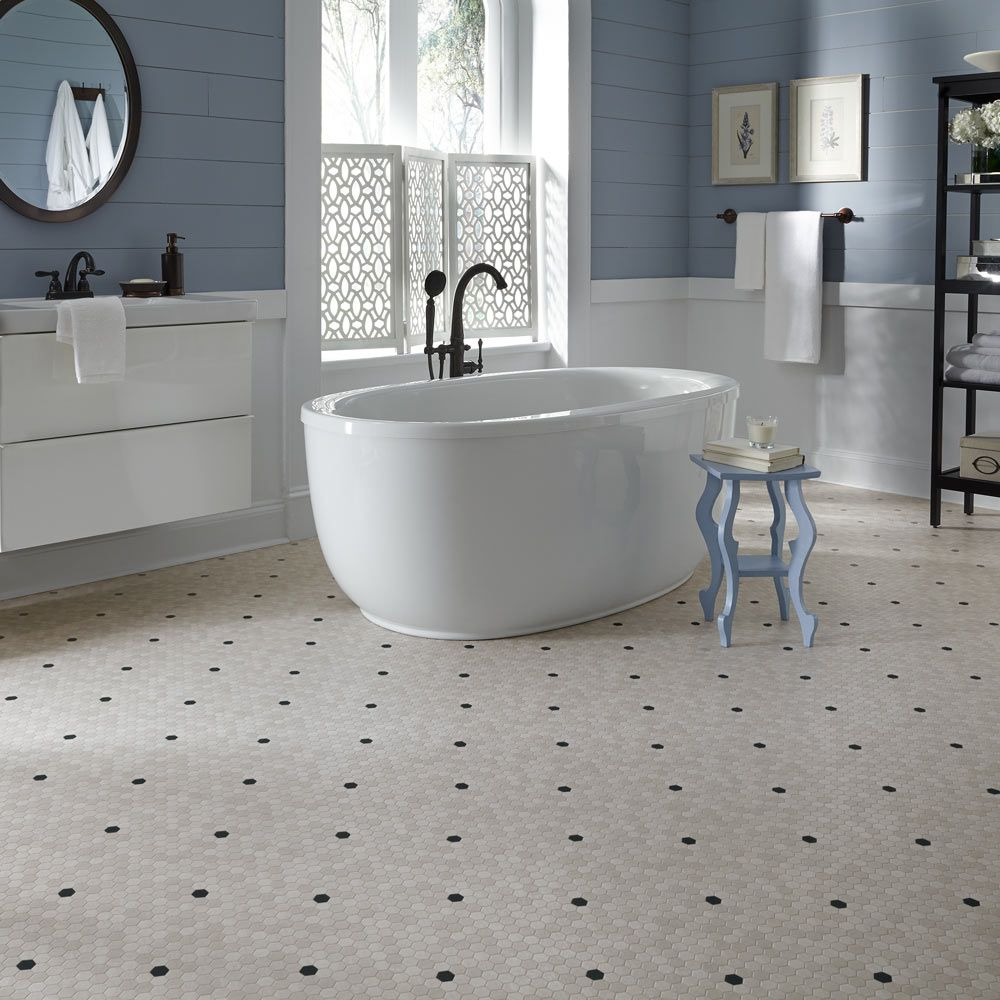 A 1920 39 s throwback design penny lane lvs is a small scale for Tile linoleum bathroom