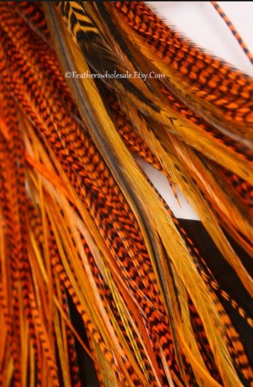 Orange auburn feather hair extensions