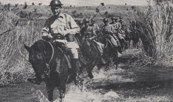 Captain John Wheeler leading the Machine Gun Troop of the 26th Cavalry Regiment(PS)(Horse) just prior to the Japanese invasion. From the cover of the March/April, 1943 issue of The Cavalary Journal.