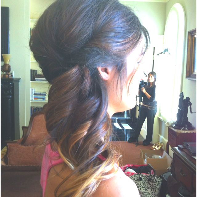 Curled, teased on top, pinned to side