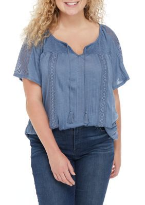 Almost Famous Plus Size Smocked Yoke Peasant Top. Accented by sheer lace panels on the sleeves, this smocked yoke peasant top from Almost Famous is destined to be a wardrobe favorite.