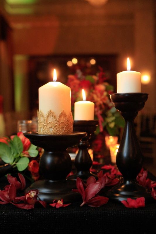 Gothic-style candles set the scene at this Halloween wedding! @deanmichaels