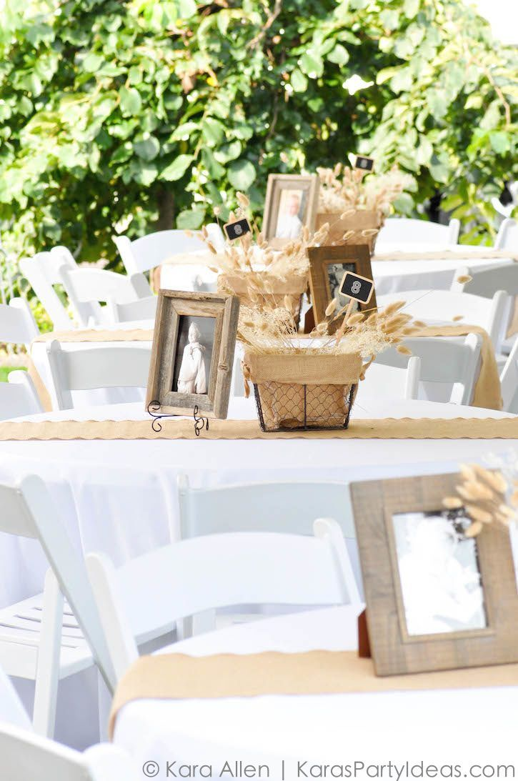 Centerpieces and tables at a chalk chalkboard burlap