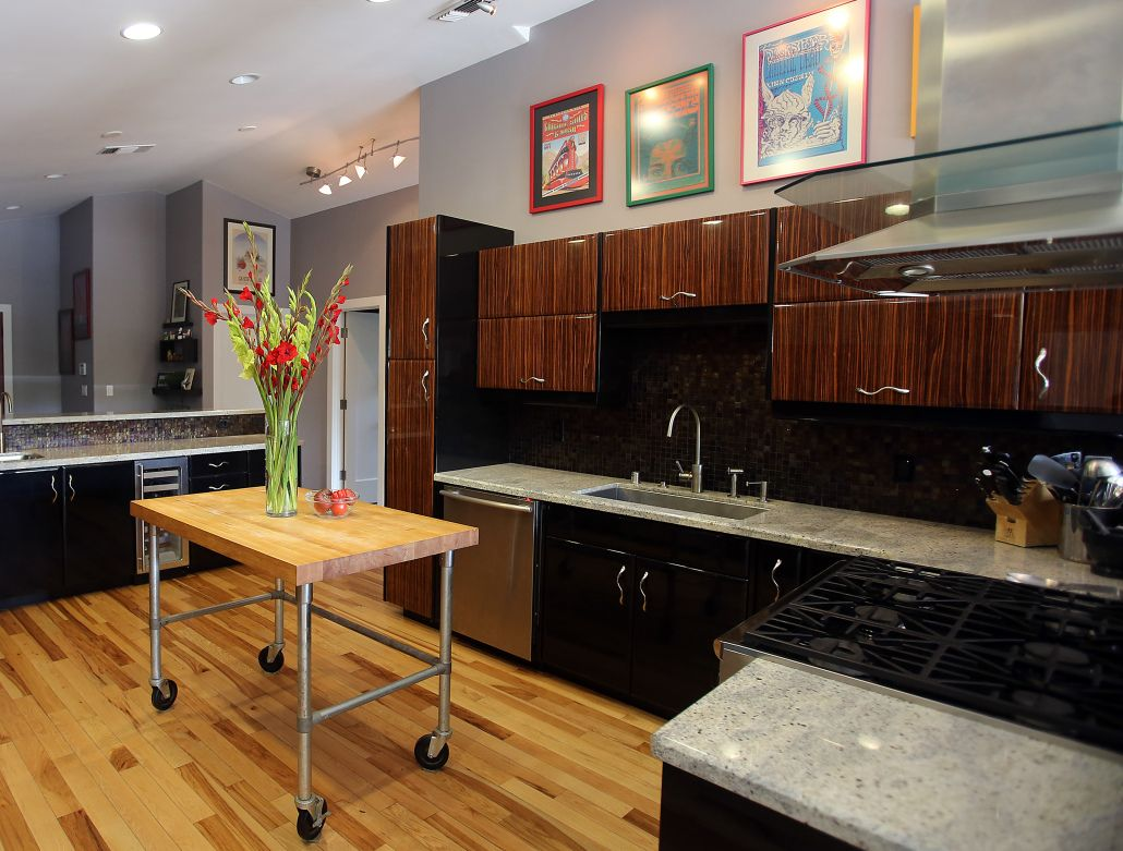 This Dynamic Kitchen Is At The Heart Of The House With Striking Zebra Wood And Black La Commercial Interior Design Interior Design Firms Interior Design Studio