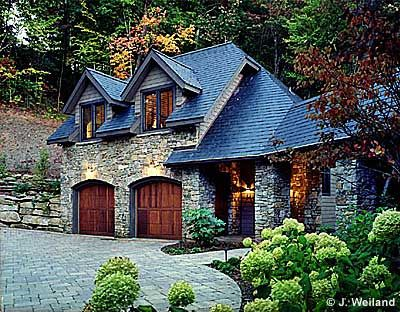 Stone House With Wood Garage Doors
