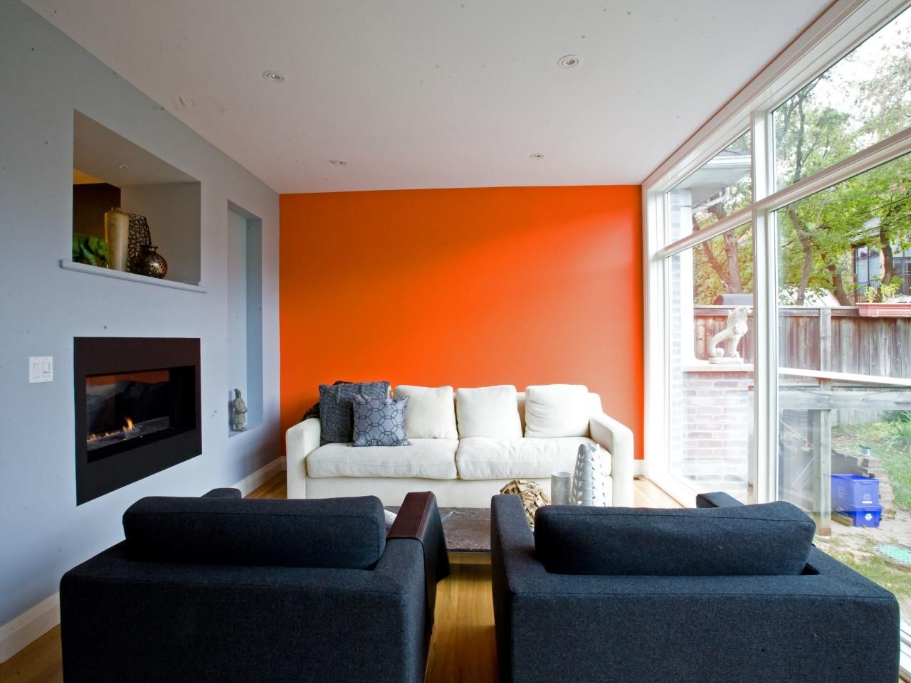 This Contemporary Living Room By Capoferro Design Features An Orange Accent Wall Gorgeous Fireplace And