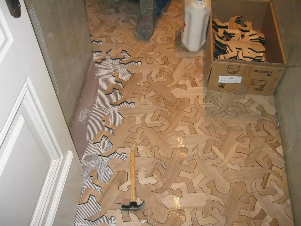 Floor tile inspired by M. C. Escher's work.