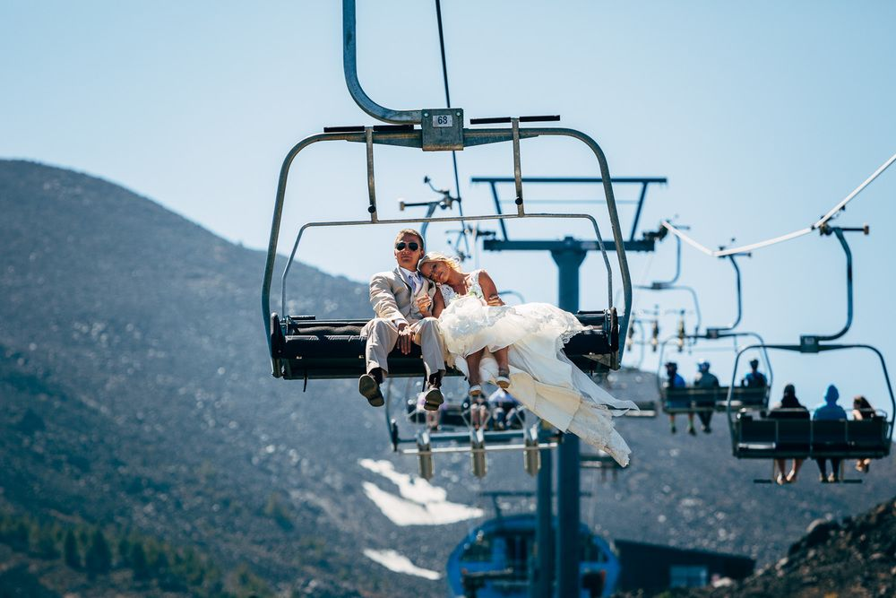 Bride and Groom getting some quite time while riding down the chair lift from Mt Bachelor, Oregon after we did a first look up the mounain.
