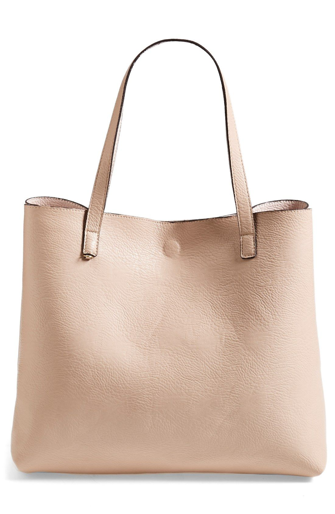 66aae5a3dc Love that this reversible vegan leather tote comes with a matching wristlet.