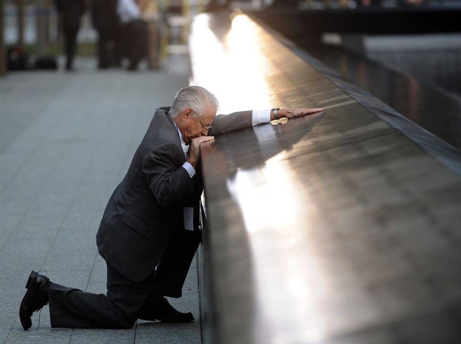 A father pauses to remember his son at the WTC site. This is heartbreaking...