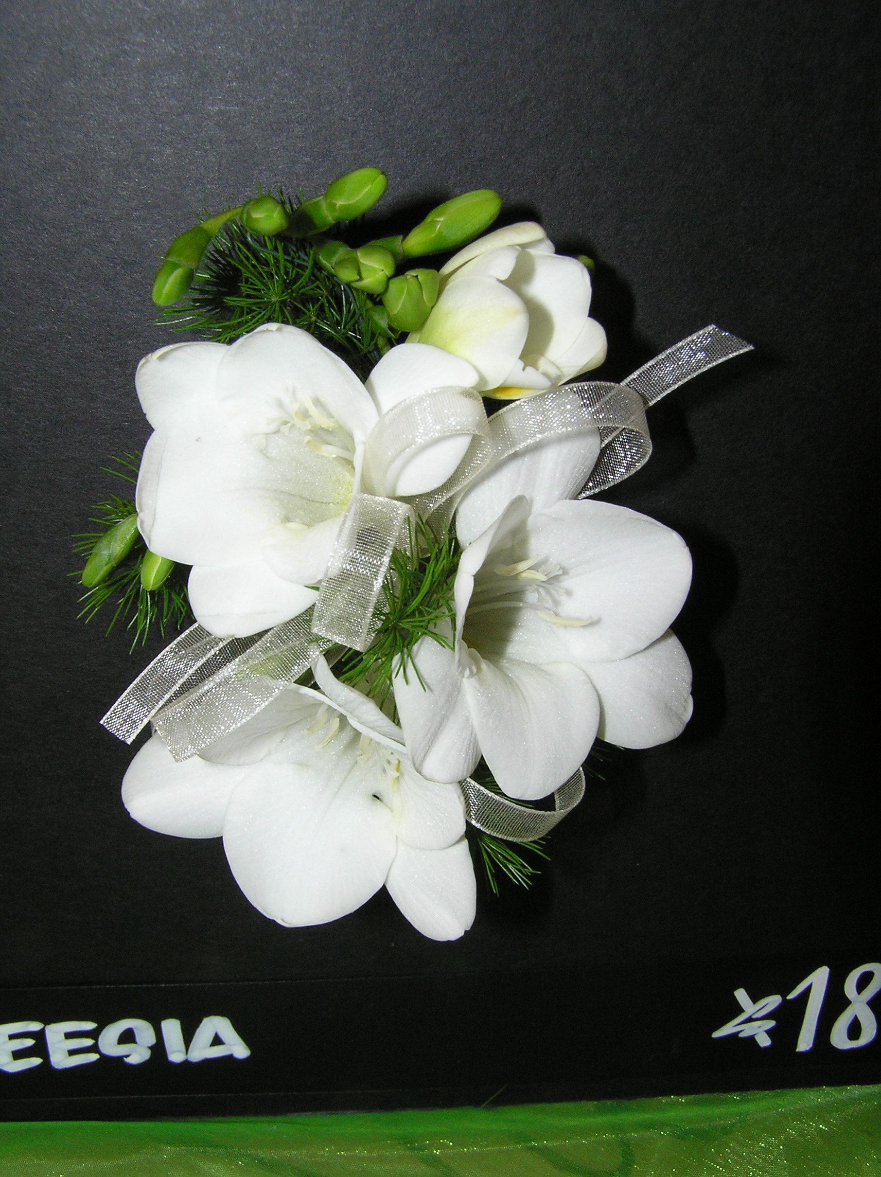 Wrist Corsage - Fragrant White freesia with white sheer ribbon