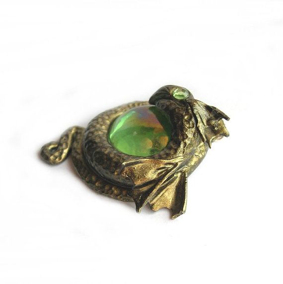 Golden dragon pendant with green eye by MairiTales on Etsy, $20.00