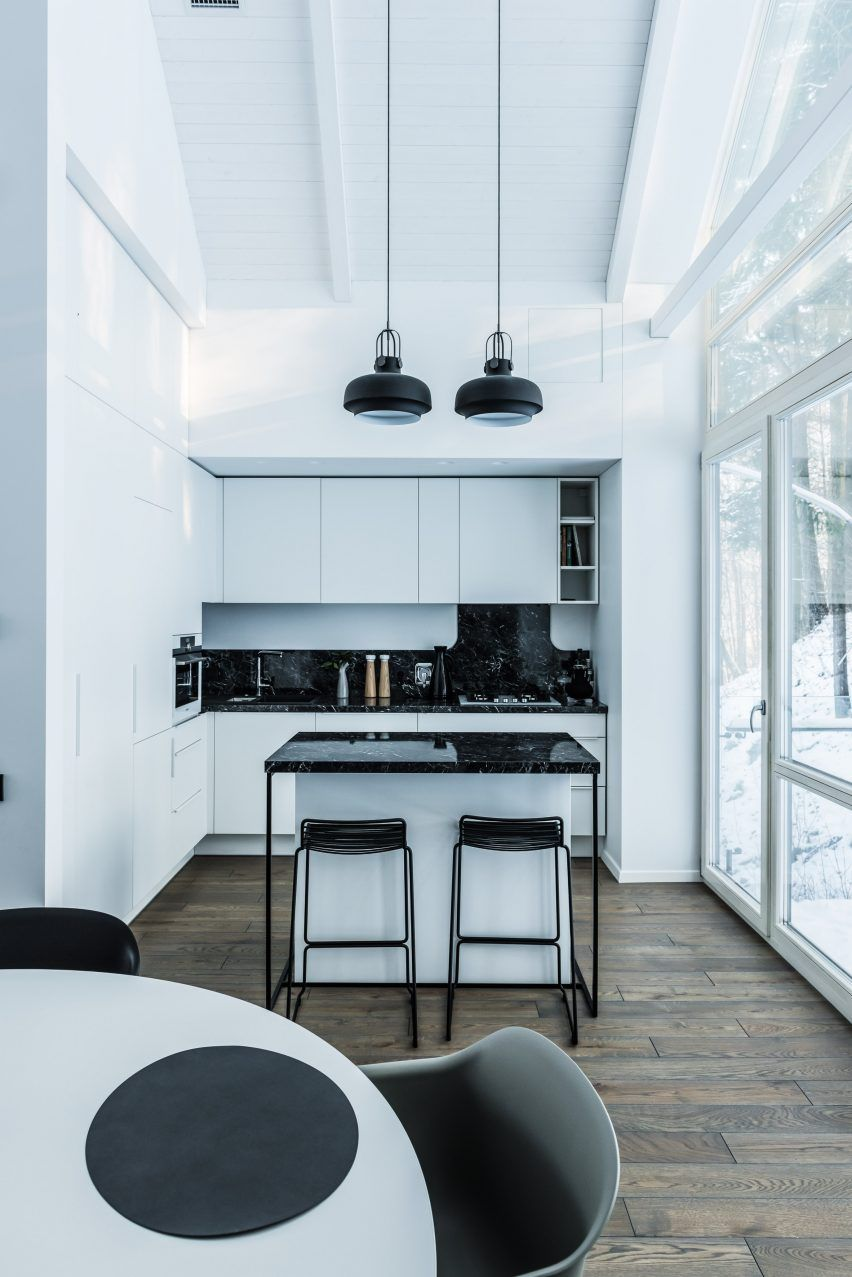 Minimal open-plan kitchen and living area features in this house in ...