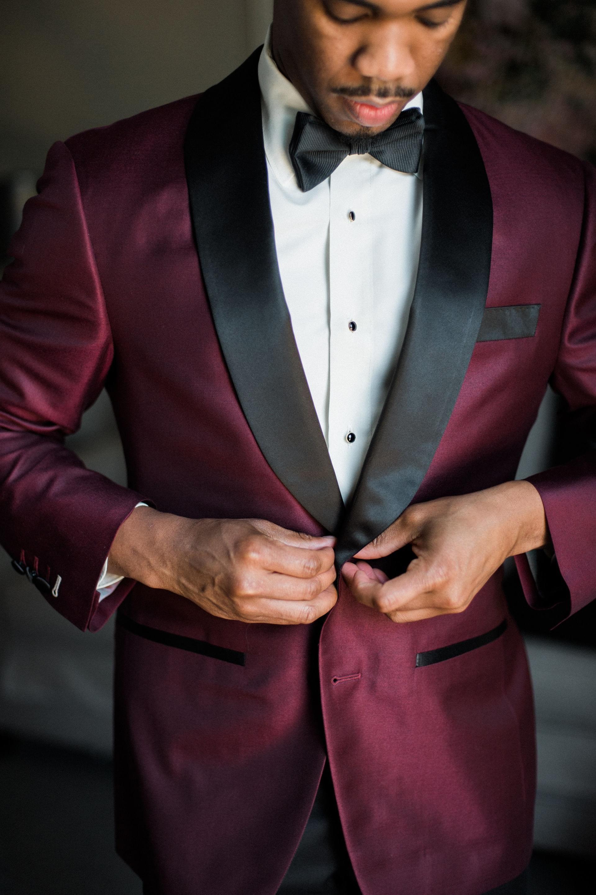 Burgundy suit black lapels bowtie retrochic groom