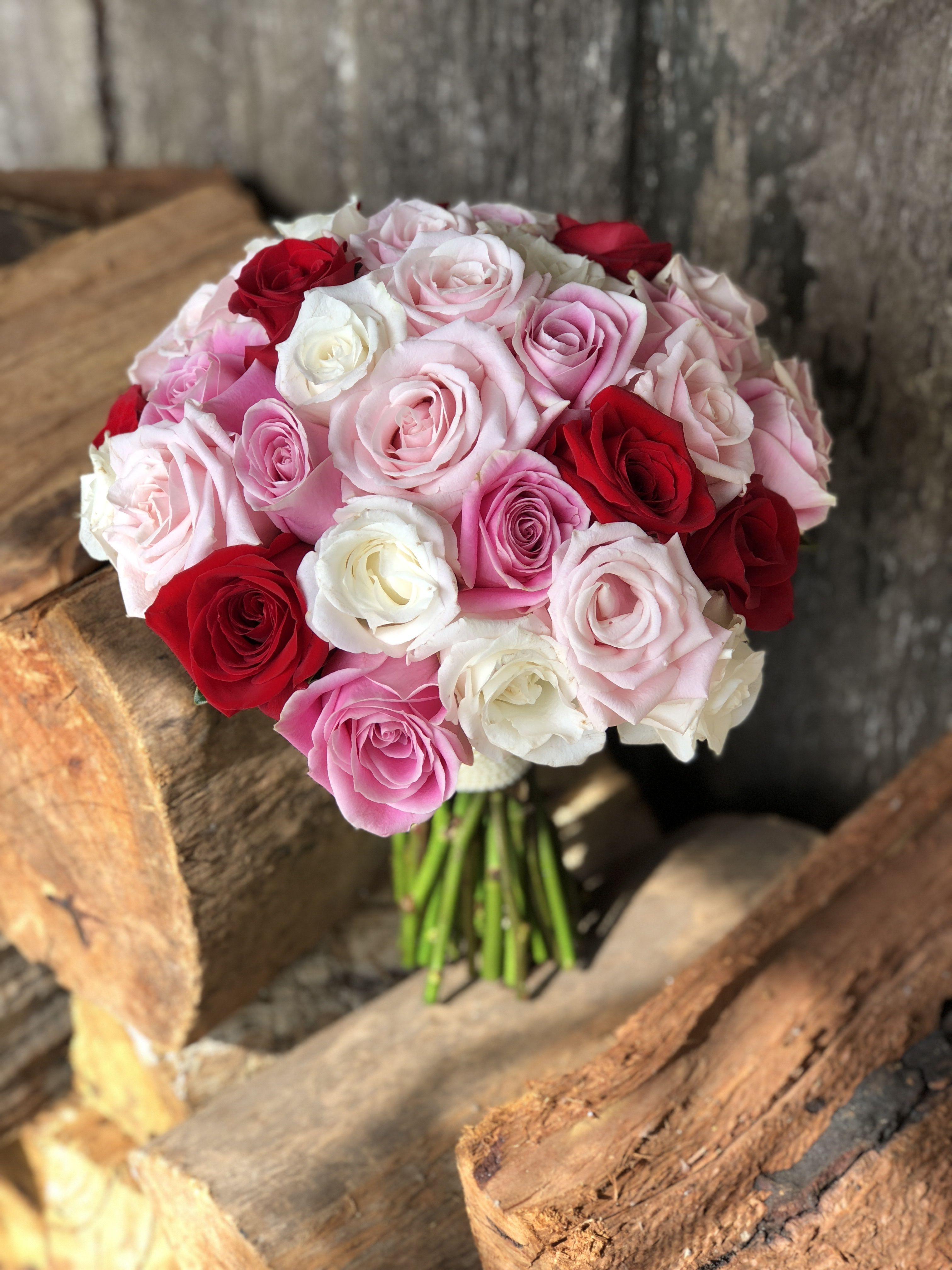 Bridal Bouquet Of White Soft Pink Candy Pink And Red Roses