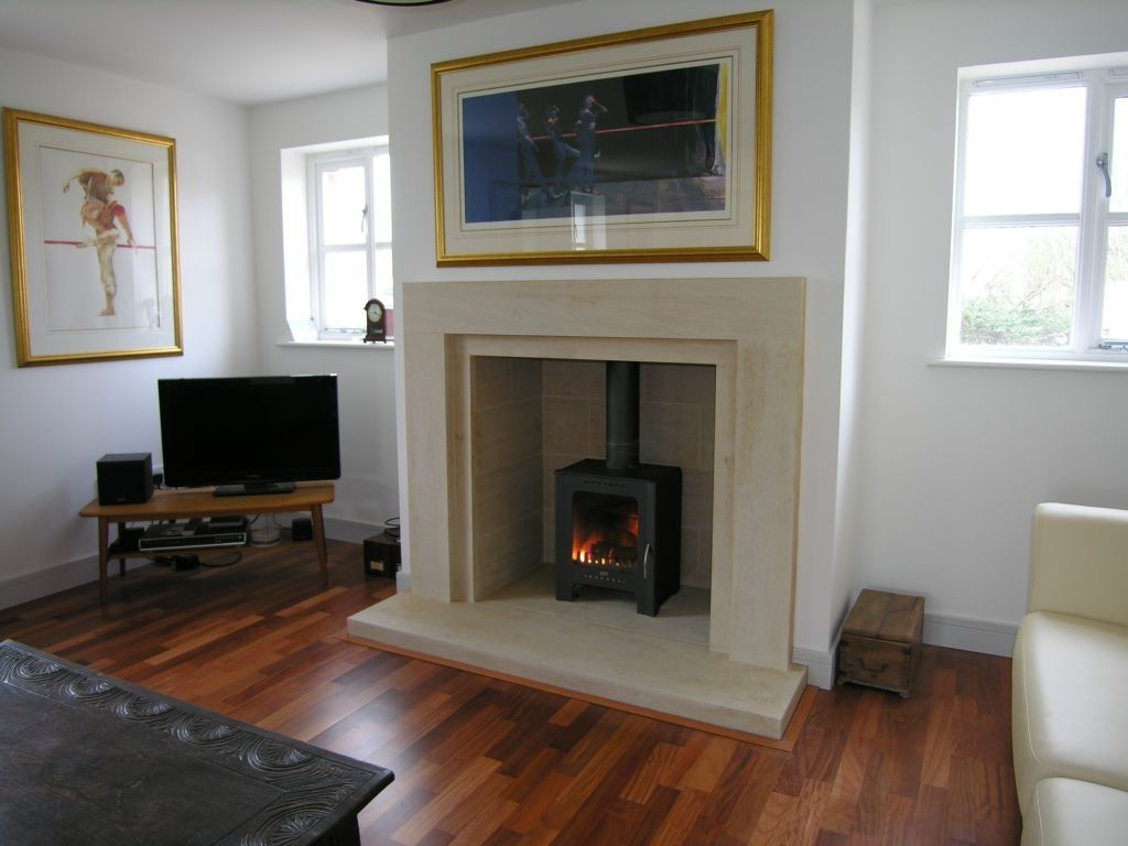 Contemporary plain and simple stone fireplace. Templestone ...