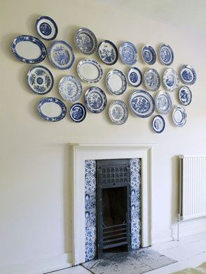 just look how those plates draw out the colors in the tile surrounding the - Decorative Wall Plates