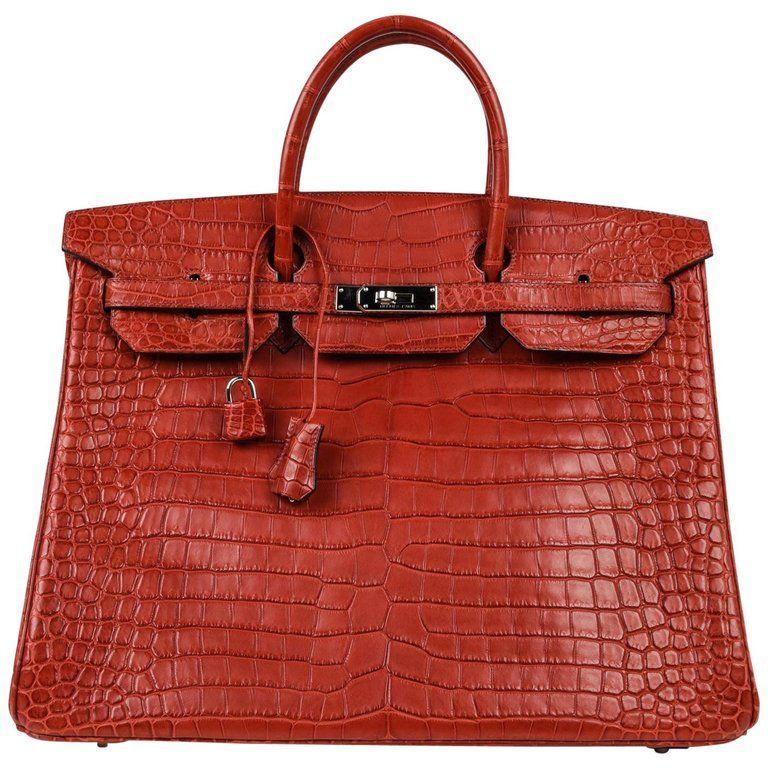 b6ff88bf7c6 Guaranteed authentic rare Hermes Birkin 40 bag. Coveted Matte red Porosus  Crocodile birkin with fresh palladium hardware. Extremely light wear marks  on