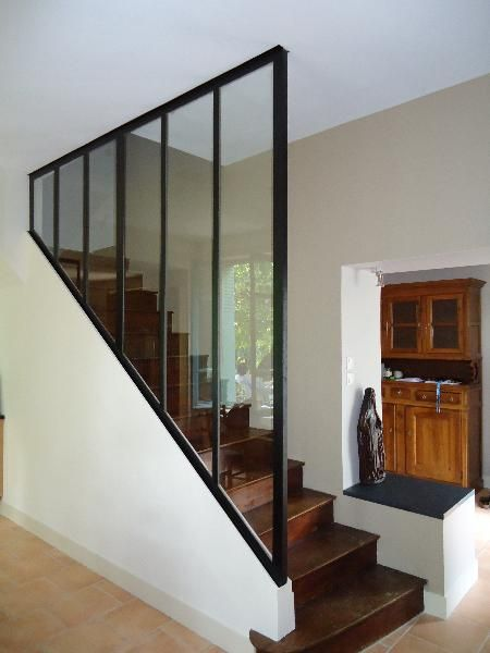 dark treads, light walls, no rail, glass partition to ceiling