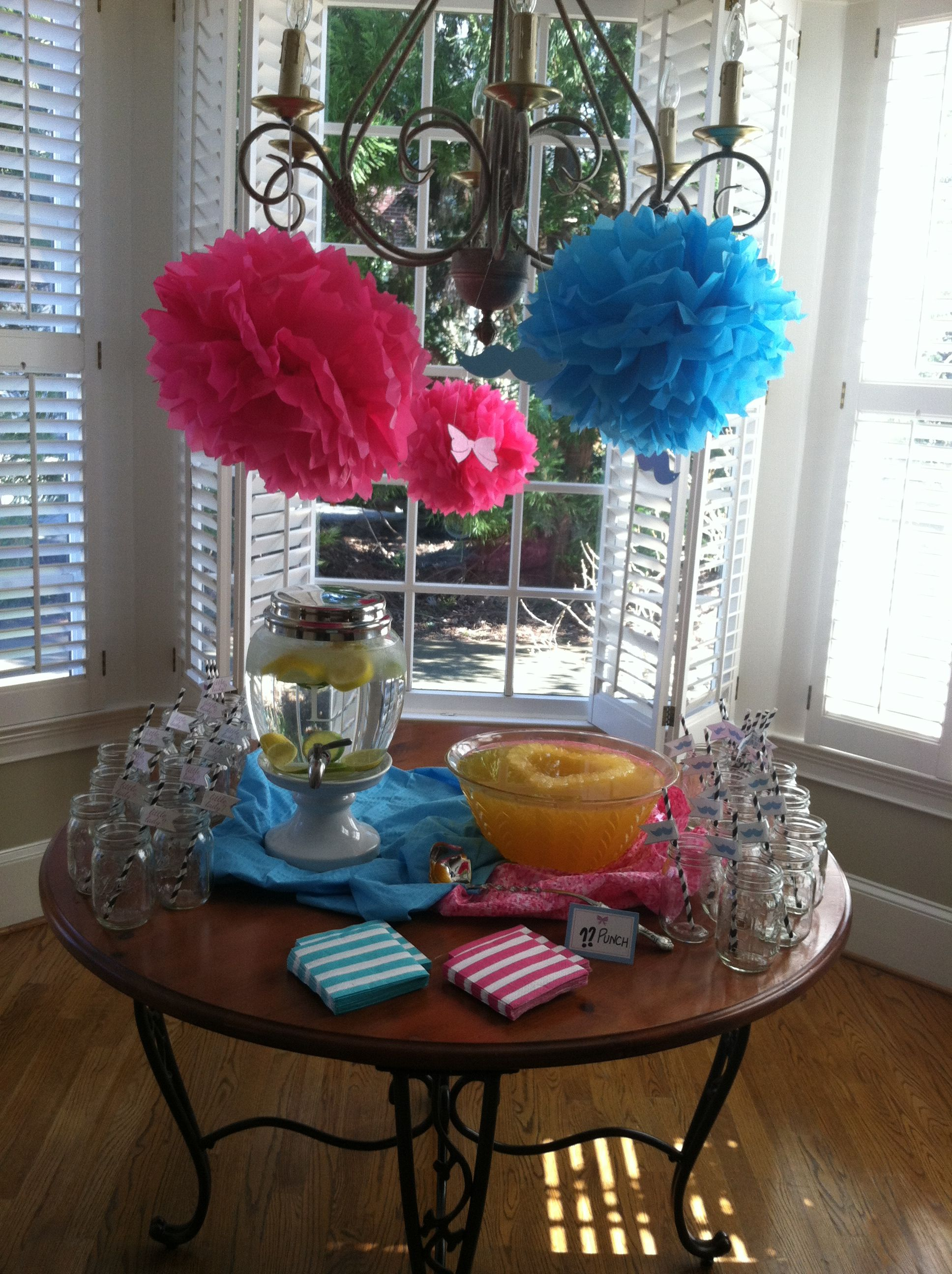 Drink station with mason jars as cups, black & white paper straws from Michaels, flags from a file bought from Nounces Designs off Etsy, gender neutral punch, tissues poofs from Hobby Lobby (cheaper to buy than make!), cut outs of mustaches & bows made from Silhouette Cameo.