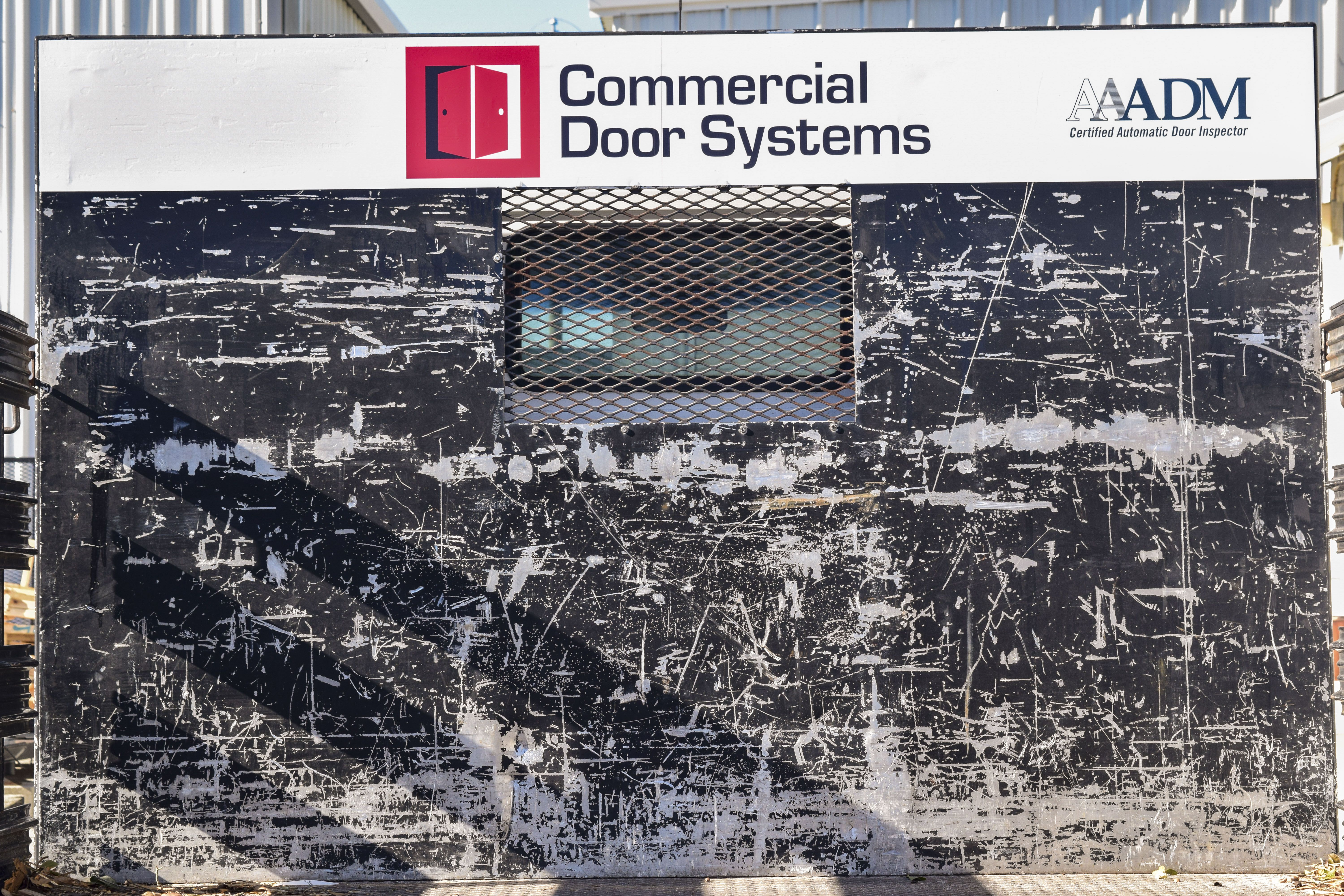Commercial Door Systems Graphics By Pensacola Sign In Pensacola, Florida.  🚗💨 On Average