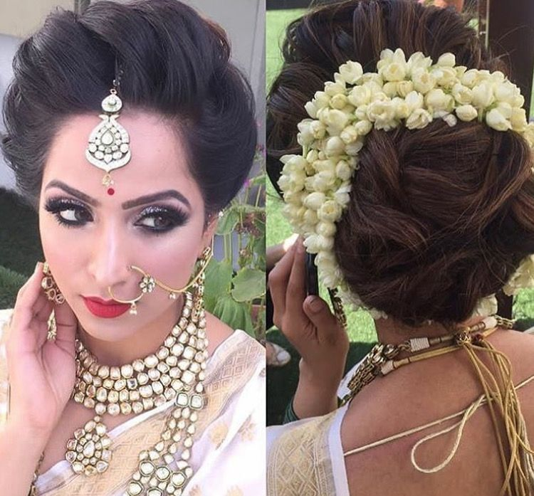 What A Beautiful Large Low Bun With Real Flower Gajra Care However Should Be Taken Before Adopting S Indian Bridal Hairstyles Bridal Hair Updo Bridesmaid Hair