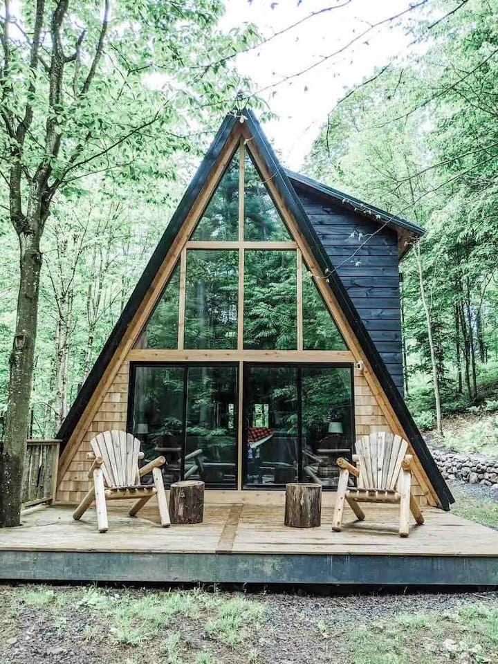 The AFrame at Evergreen Cabins Sleep under stars
