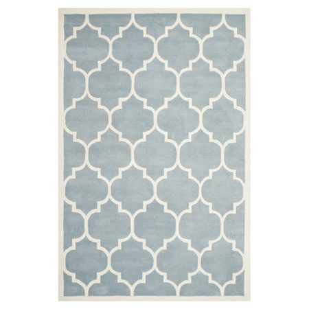 Anchor your living room seating group or define a space in your master suite with this hand-tufted wool rug, showcasing a trellis motif in blue....