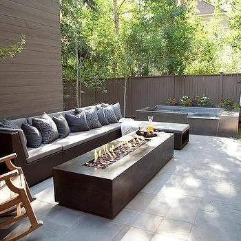 Awesome Modern Patio Features A Modern Outdoor Sofa With Chaise Lounge Facing A  Modern Long Fire Pit.