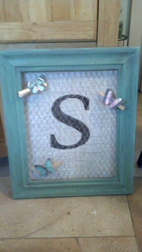 Custom chicken wire frame with initial and butterfly clothespins ...