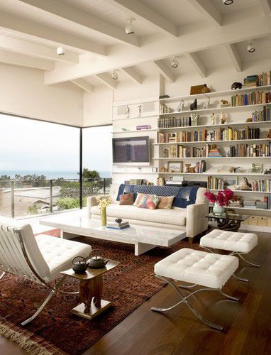 A Winning Trifecta Leather, Mid-Century Modern and Oriental Rugs
