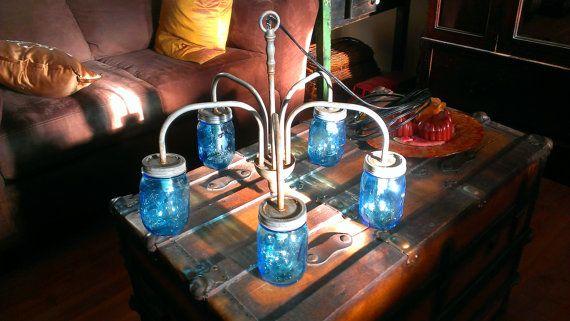 Repurposed chandelier with blue mason jar by SalvationHomeDecor