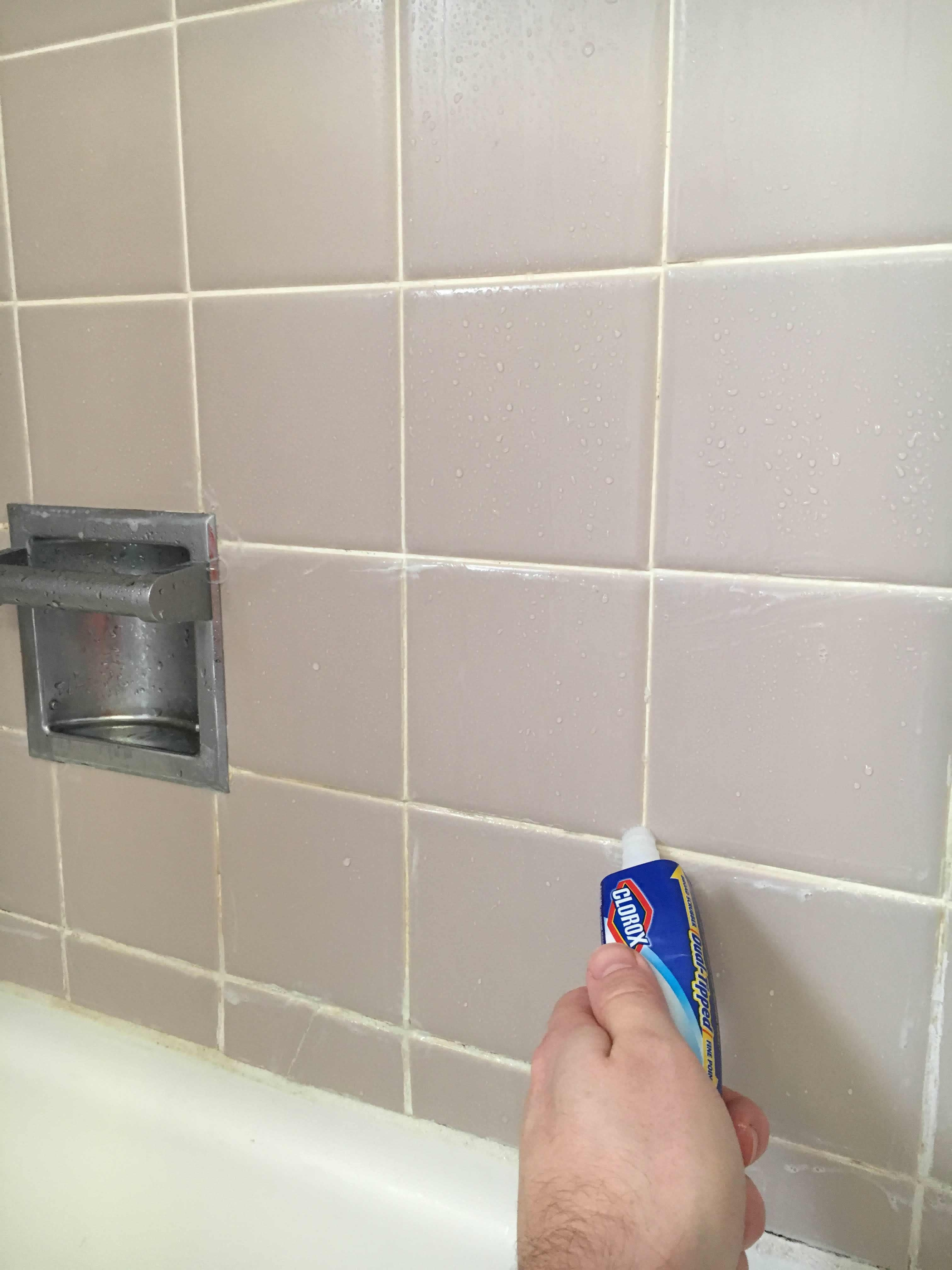 Cleaning shower grout with a bleach pen cleaning