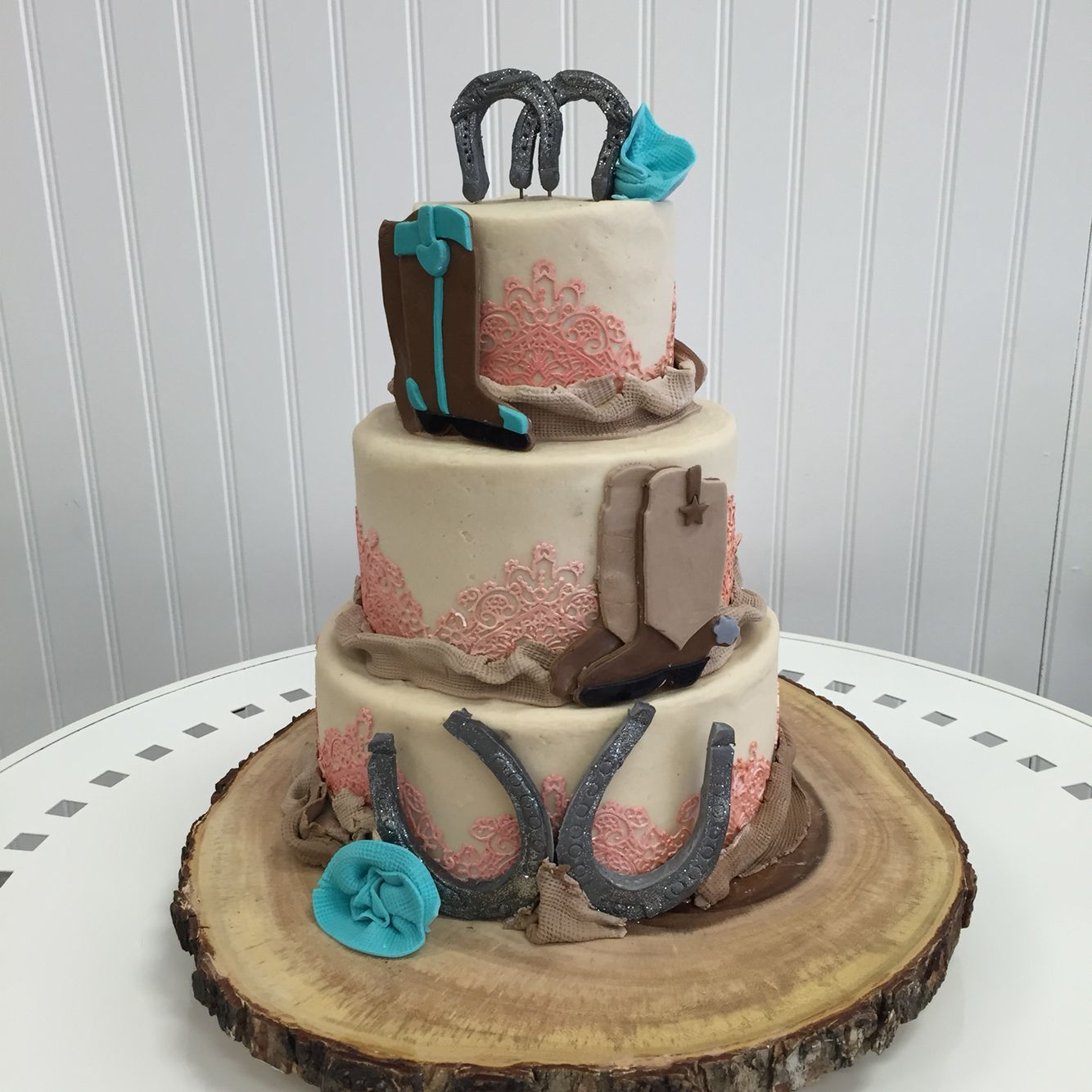Country themed wedding cake with turquoise and coral