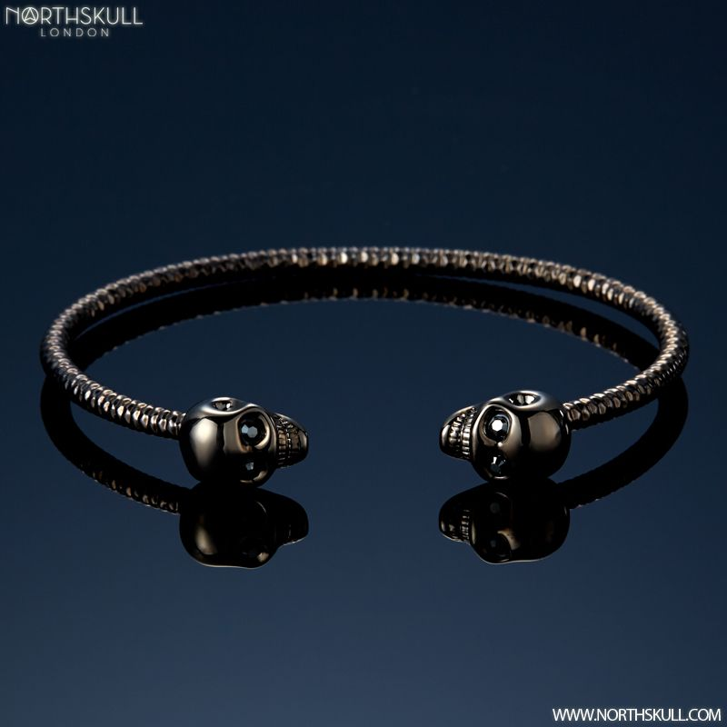 Our Gun Metal Black Facetted Twin Skull Bangle Is A Sleek & Stylish  Addition To Your