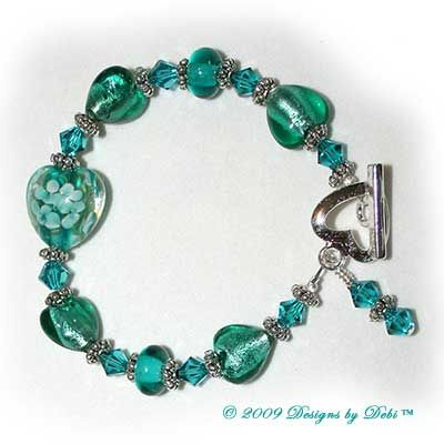 Designs by Debi Handmade Jewelry Teal Hearts and Swarovski Crystal Blue Zircon Bicones Bracelet with a Silver Heart Toggle Clasp $24