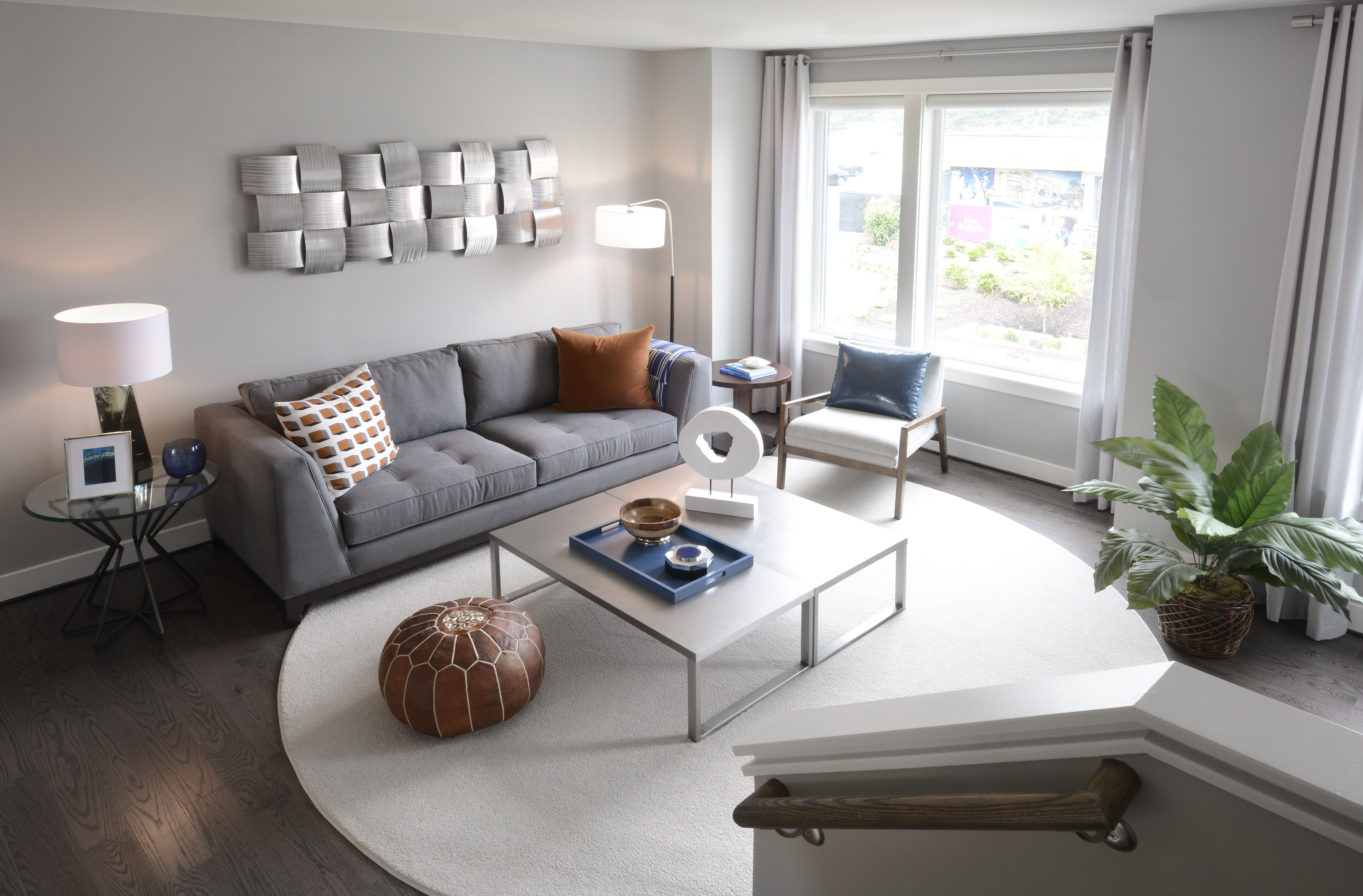 modern gray and white living room with red and blue