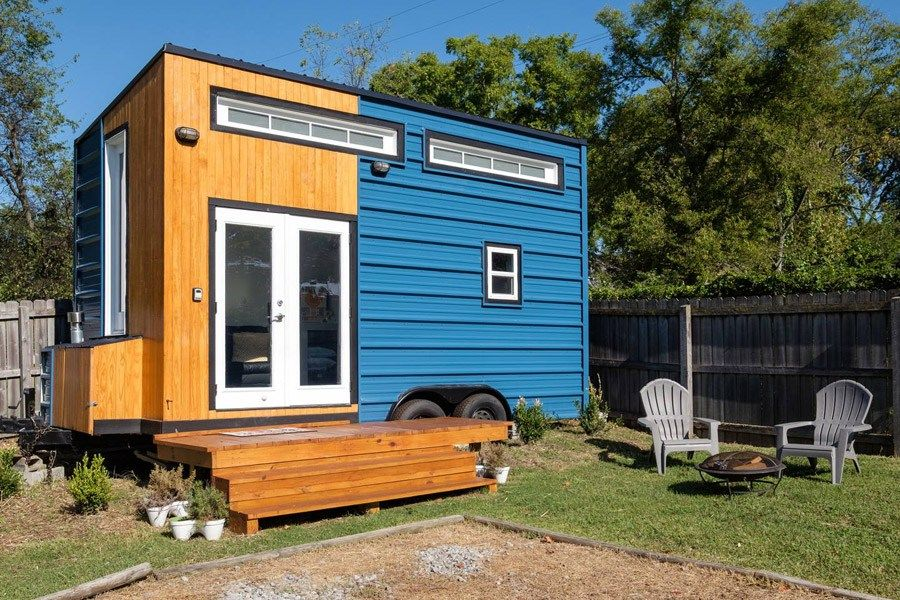 185 sq ft tiny house on wheels in Nashville that you can rent for the night. The home can comfortably fit three people and comes with a full kitchen, full bathroom, a living/dining area, stairs tha...
