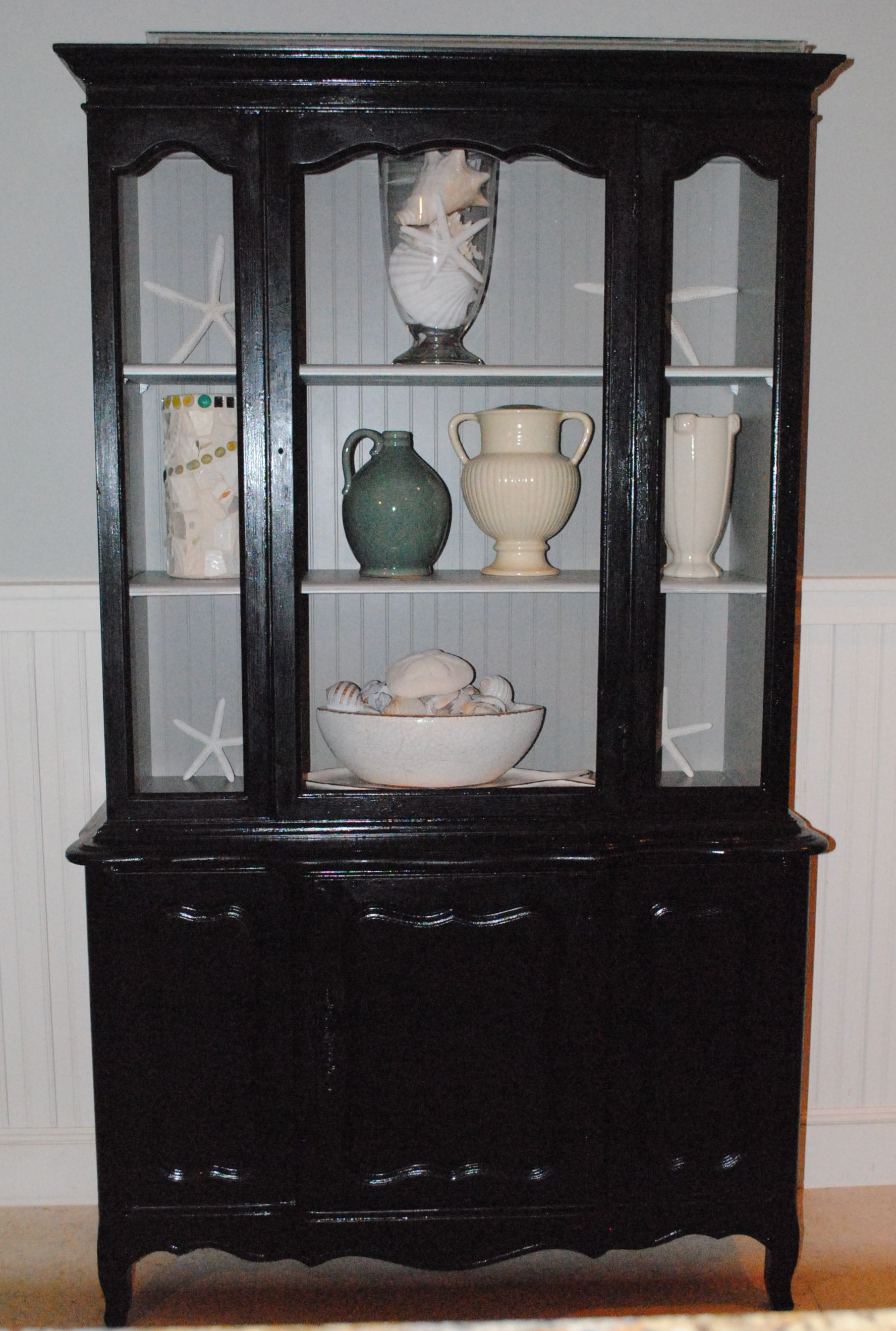 my old bathroom china cabinet painted black with taupe insides