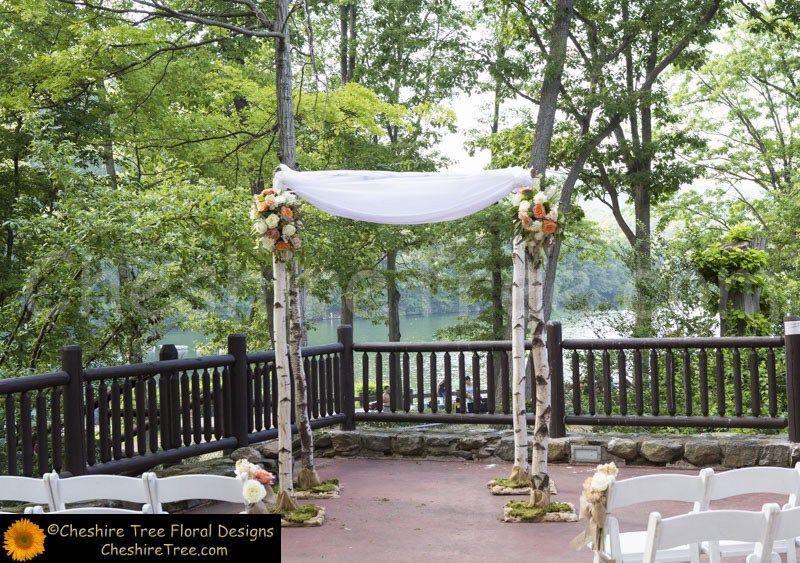 !schwartz-20-bear-mountain-inn-wedding-flowers-ceremony-chuppah-white-birch-moss-roses-orange-white-organza-hessian-lake