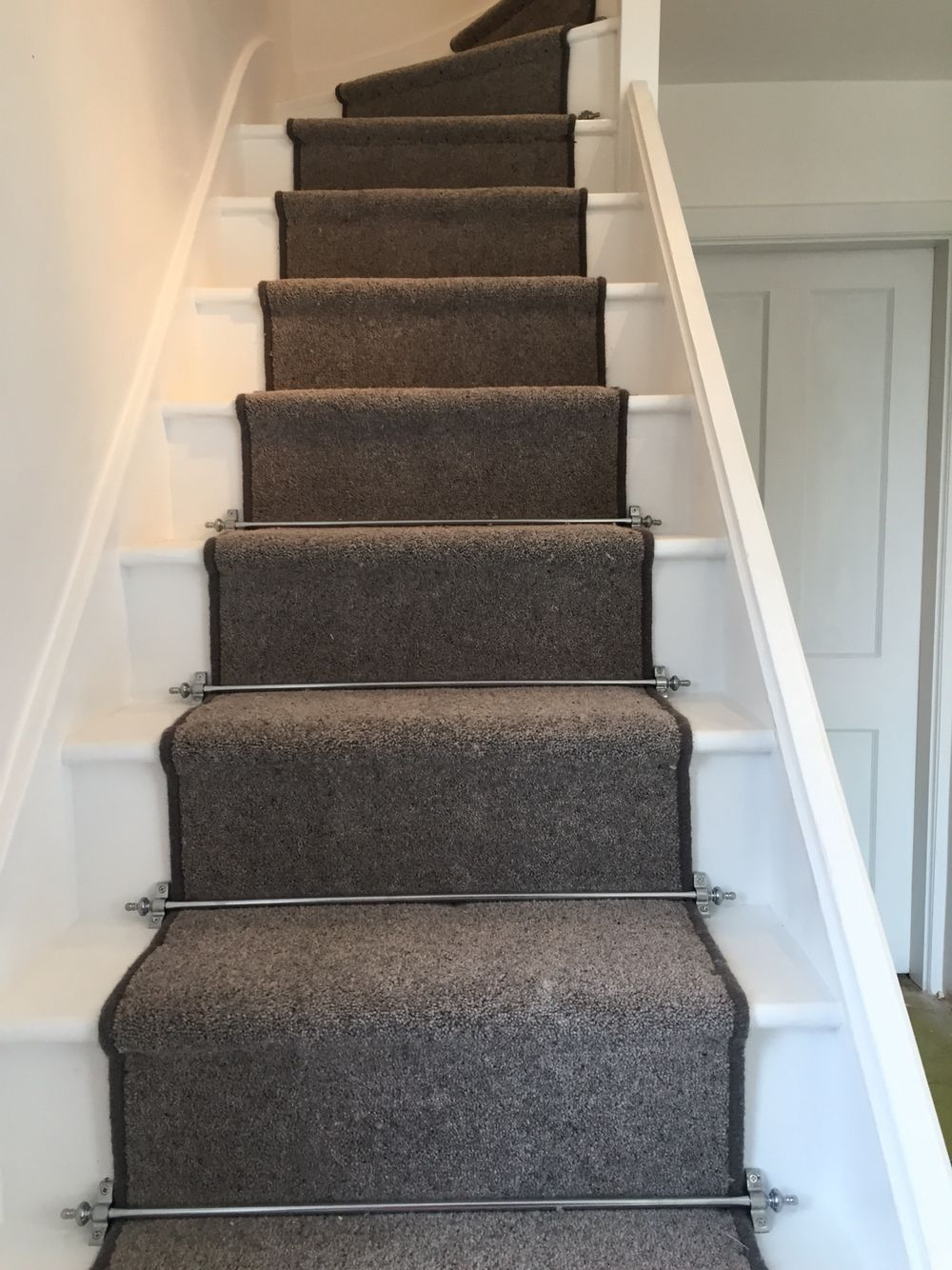 Grey Carpet Runner And Chrome Carpet Rods On White Painted Stairs | Painted Stairs With Carpet | Middle | Design | Diamond Pattern | Victorian | Laminate