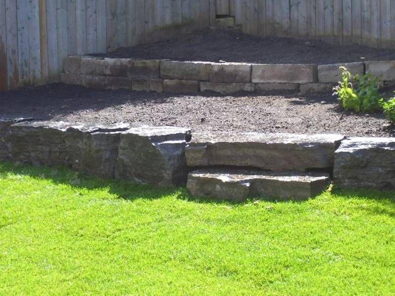 rock walls Tiered landscape, Farm landscaping, Stone